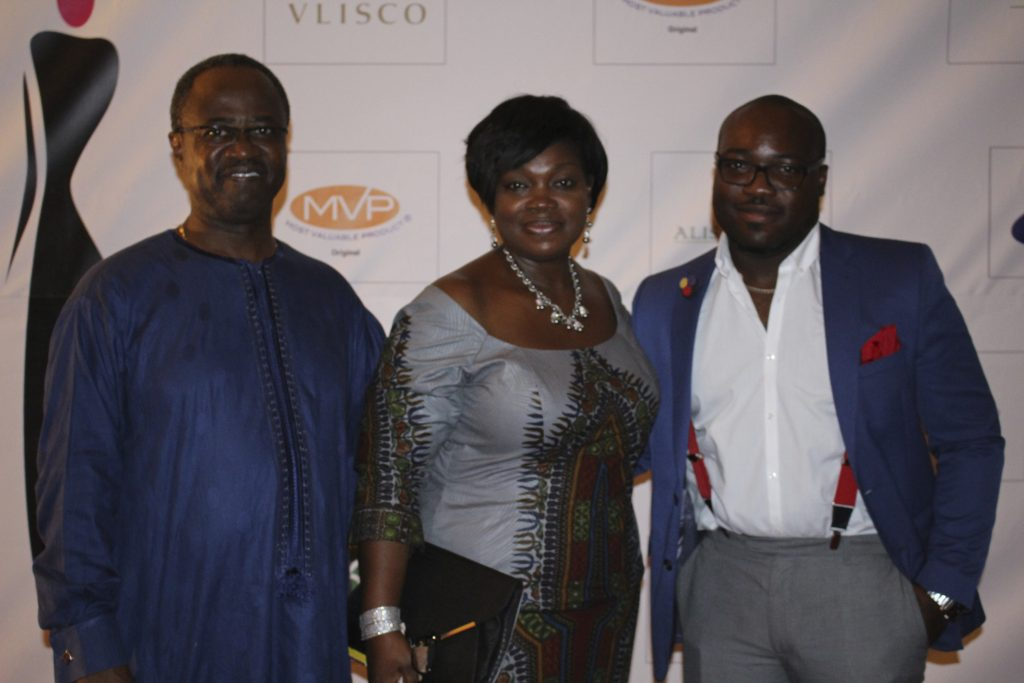 ellen-flanked-by-husband-gilbert-and-son-kofy-at-the-glitz-africa-fashion-show-2013